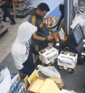 Case of cigars stolen by man in black and yellow track suit